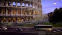 Slow motion pan of vehicles on the street next to the Colosseum.