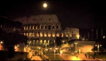Full moon above illuminated Colosseum at night