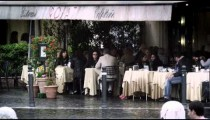 A little cafe on a street in Rome.