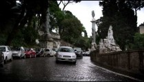 Slow motion footage of cars passing the Fontana del Nottuno