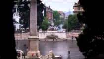 Distant shot of Fontana del Nottuno and obelisk at Piazza del Popolo