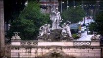 Slow motion of Fontana del Nottuno and obelisk on a rainy day