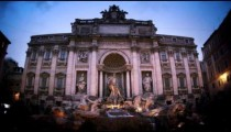 Slow motion footage of the Trevi Fountain at dusk
