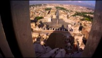 Tracking footage of Rome skyline from behind guardrail