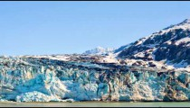 View of a big ice glacier and snow covered mountains in Glacier Bay.