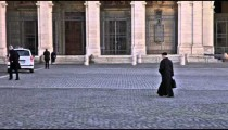 Man walks across Piazza San Giovanni