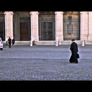 Man walks across Piazza San Giovanni