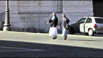 Two nuns crossing a street