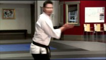 Close up of a man performing Tae Kwon Do.