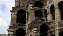 Shot looking up at the tourists on the outside balconies of the Colosseum.