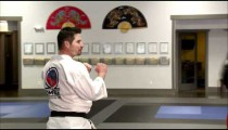 Close up of a bag being kicked at a karate studio.