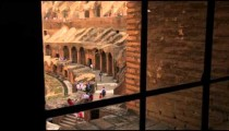 Behind bars overlooking tourists in Colosseum