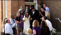 Guests throwing rice over a newlywed couple.
