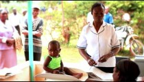 KENYA-C.2012 A woman sits her baby for its physical examination by a doctor in Kenya, Africa c.2012