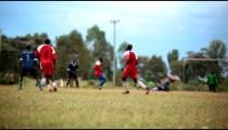 KENYA-C.2012 Two teams of African teens play an intense game of football in Kenya, Africa c.2012