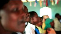 KENYA-C. 2012 A young woman sings and dances with her congregation during worship in Kenya, Africa