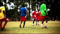 KENYA-C.2012 Red team of football players gather in a huddle in Kenya, Africa c.2012