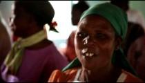 KENYA-C.2012 A woman wearing a head scarf sings and dances during worship in Kenya, Africa c. 2012.