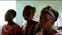 KENYA-C. 2012 Three women sing, dance, and smile as part of a group in Kenya, Africa c. 2012.