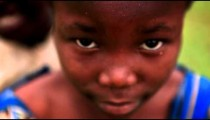 KENYA-C.2012 A young black girl looking; another child looks over her shoulder in Africa c.2012