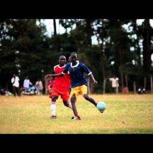 KENYA-C.2012 Two teams of African boys play an intense game of football in Kenya, Africa c.2012
