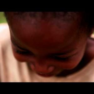 KENYA-C. 2012 A young boy laughs shyly at the camera in Kenya, Africa c.2012