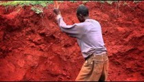 Close up of a man digging in a deep pit
