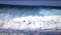 Slow motion shot of a surfer who gets wiped out by the big waves near a beach in Costa Rica.