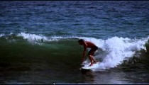 Slow motion shot of a man surfing along the coast of Costa Rica