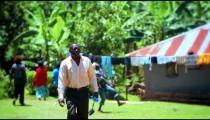 Panning shot of a scene in a villlage in Kenya.