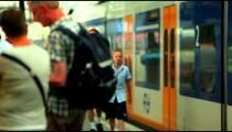 AMSTERDAM-C.2012: Passengers crowd platform as train leaves Amsterdam Centraal Station, c.2012.
