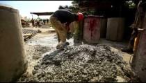Man shoveling gravel at construction site
