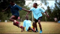 KENYA-C.2012 Two teams clash over a ball during a football match in Kenya, Africa c.2012
