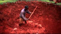 High angle footage of man digging a pit