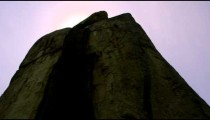 Low angle footage of enormous rock