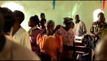 KENYA-C. People sing and dance between benches and in the aisle during worship in Kenya, Africa.