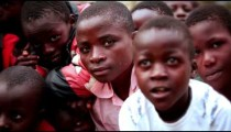 KENYA-C.2012 Young boys crowd together to smile for the camera in Kenya, Aftrica c.2012