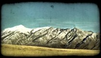 Field and mountains 2. Vintage stylized video clip.