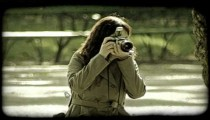 Woman takes picture. Vintage stylized video clip.