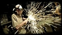 Man splices metal with a machine. Vintage stylized video clip.