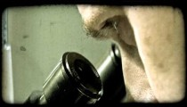 Man looks into microscope. Vintage stylized video clip.