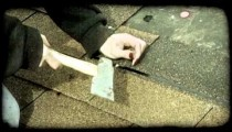 Woman nails down roofing. Vintage stylized video clip.