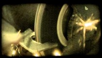Worker files metal pole. Vintage stylized video clip.