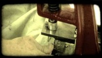 Insertion of metal rings. Vintage stylized video clip.