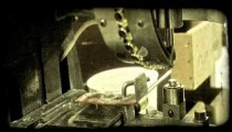 Machine puts holes in tent material. Vintage stylized video clip.