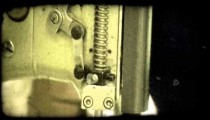 Heavy duty sewing machine. Vintage stylized video clip.