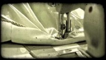Man sews end of tent. Vintage stylized video clip.