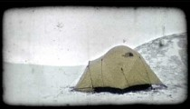 Winter tent before dawn. Vintage stylized video clip.