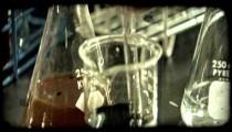 Man uses syringe in lab. Vintage stylized video clip.