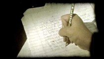 Young boy writes letter. Vintage stylized video clip.